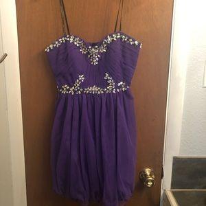 Purple strapless homecoming dress